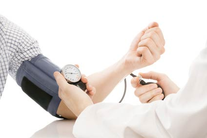 Checking blood pressure with sphygmomanometer